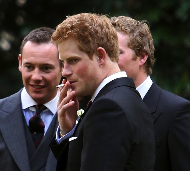 Prince Harry smoking a cigarette (or weed)