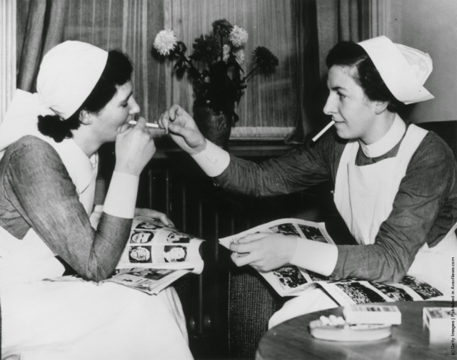 Nurses at the Salford Royal Hospital take advantage of the newly-opened smoking facilities, providing a smoke room for off duty staff. (Photo by Fox Photos/Getty Images). 1938